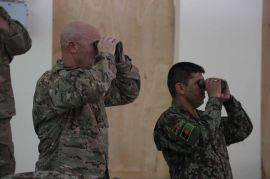 L6 U.S._Army_Command_Sgt._Maj._Scott_Schroeder,_left,_with_the_International_Security_Assistance_Force_Joint_Command,_looks_through_binoculars_during_an_Afghan_National_Army_field_artillery_call_for_fire_training_130529-A-XM609-153