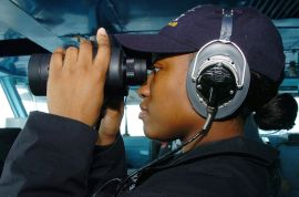 R3 US_Navy_070518-N-4420S-115_Operations_Specialist_Seaman_Caitlyn_Hagedorn_looks_through_a_pair_of_binoculars_while_standing_lookout_watch_aboard_nuclear-powered_aircraft_carrier_USS_Nimitz_(CVN_68)