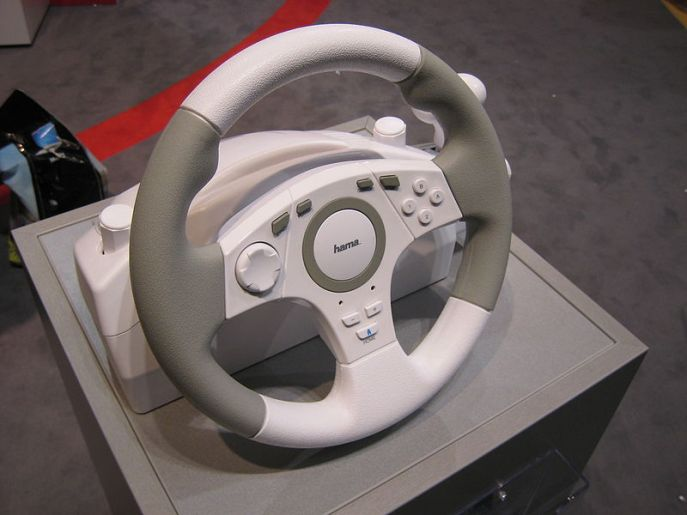 Unlike this steering wheel, mine is attached to a car. Courtesy of D-Kuru on Wikimedia Commons